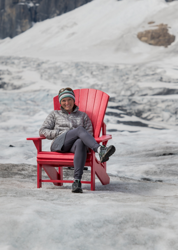 Woman Sits in Red Chair on Athabasca Glacier