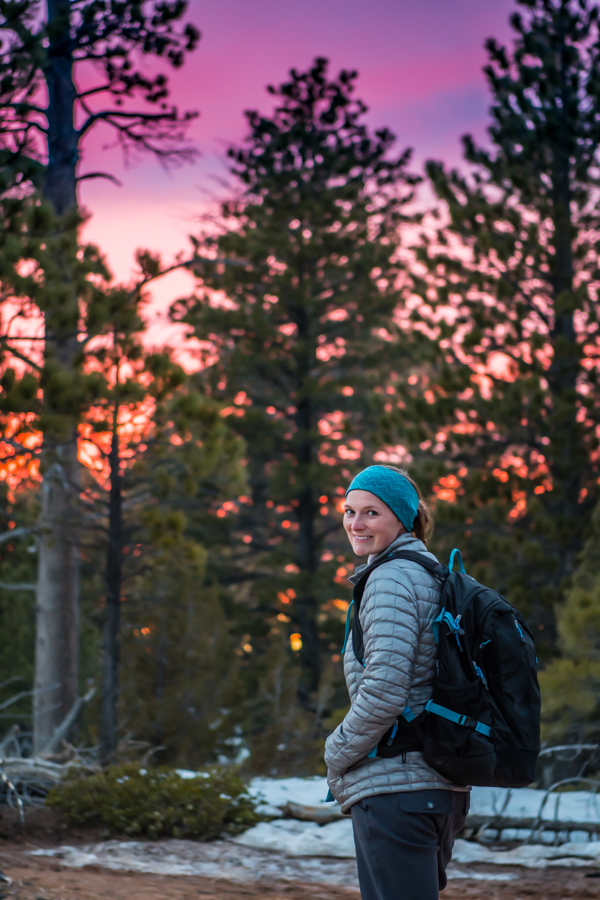 Woman Looks Back at Camera with Bright Sunset