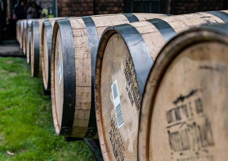 Line of Bourbon Barrels On Rail.jpg