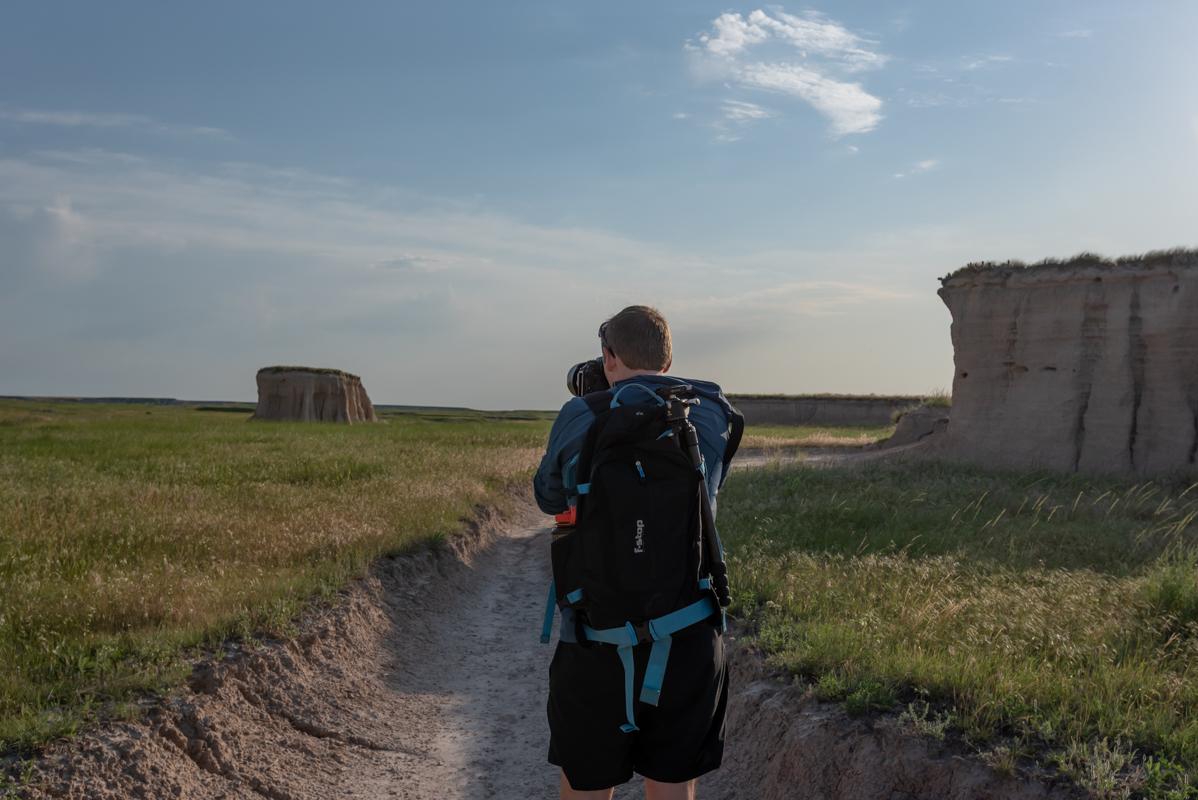 Man Taking Photograph in Badlands