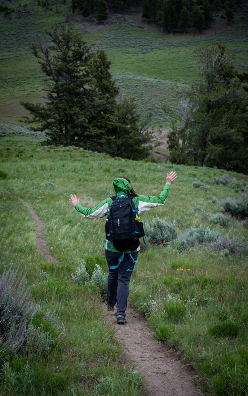 Woman Frolicks While Hiking in Yellowstone