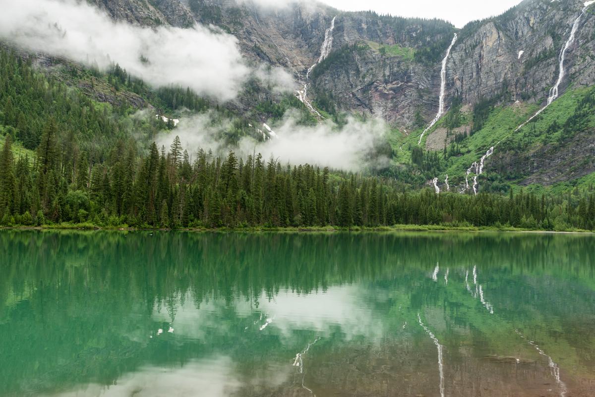 Waterfalls Reflect In Green Lake