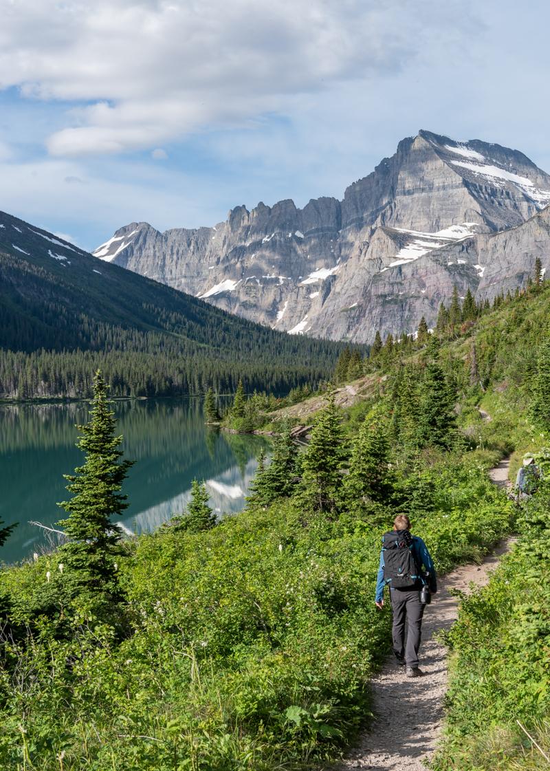 Man Hikes Next to Lake Josephine