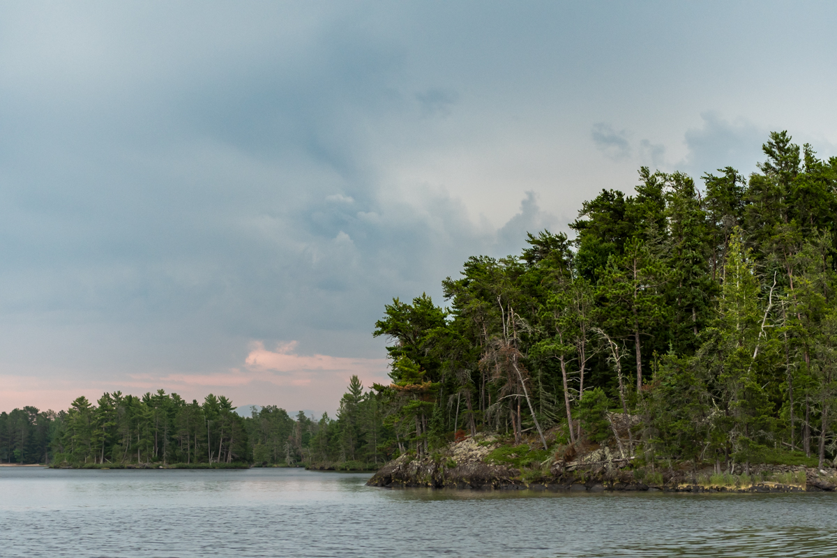 Forest and Rocks At The Edge of Rainy Lake