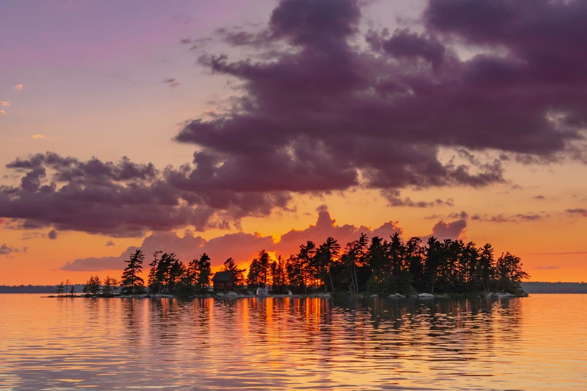 Orange Skies Behind Island and Lake
