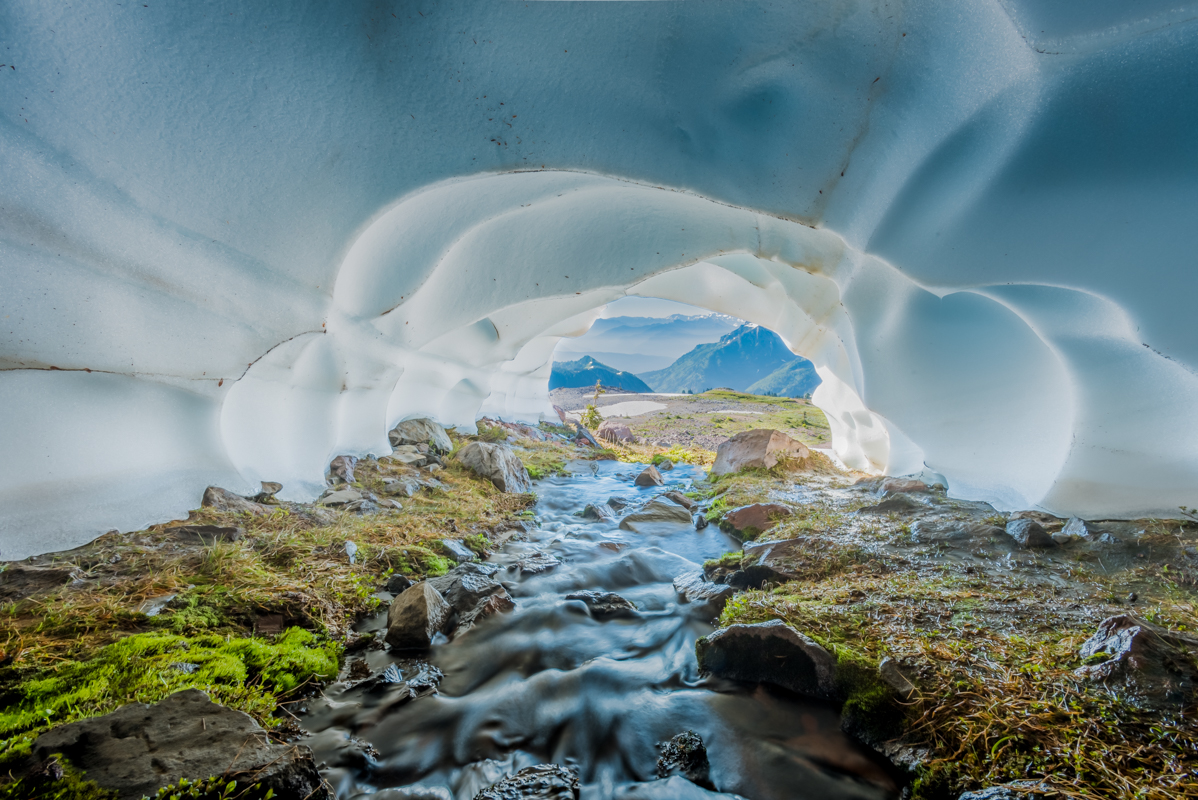 Creek Flows Through Snow Cave