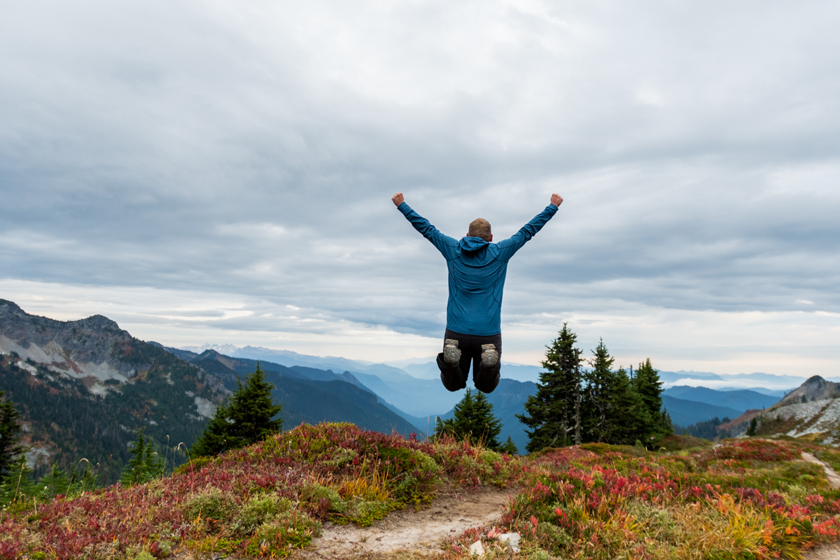 Man Jumps High in Washington Wilderness