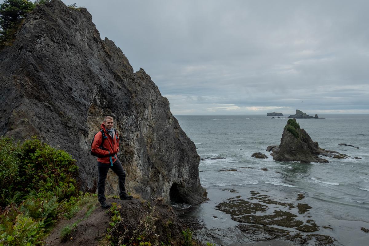 Man Smiles on Overlook to Pacific Northwest Beach