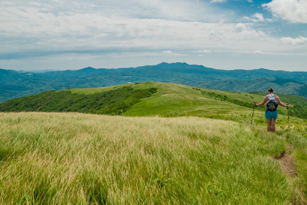 Hiker stops for a break on bald mountain