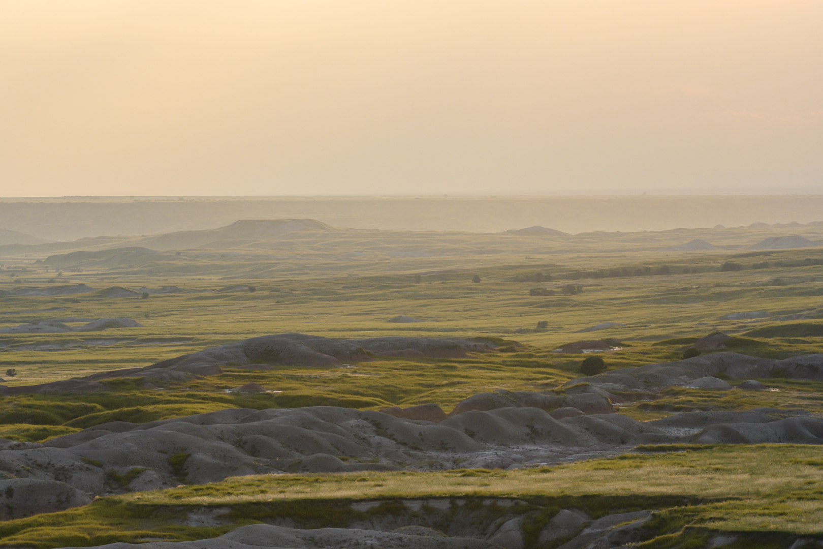 Afternoon Light Fades Over Badlands Formations