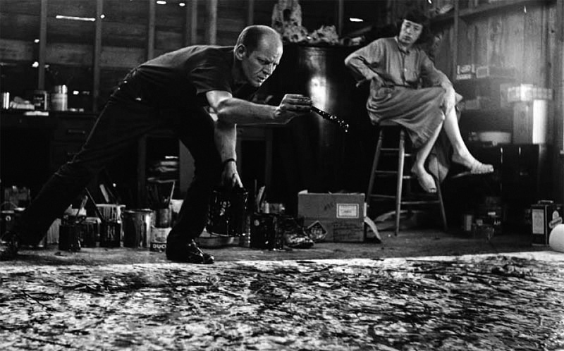 Lee Krasner watching her husband Jackson Pollock create.