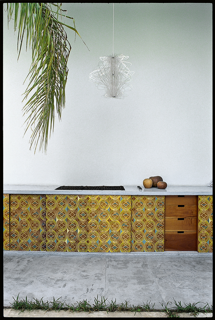 Tropical 1970's - kitchen. What is old is once again new.In design and fashion there are no new ideas, just minor adjustments to what already had its moment in time.This kitchen has paired the business of the 70's tile, honouring the deep hues of the time with the simplicity of contemporary design.This outdoor kitchen is all about the balance of good practical design and inspiring décor. -tM