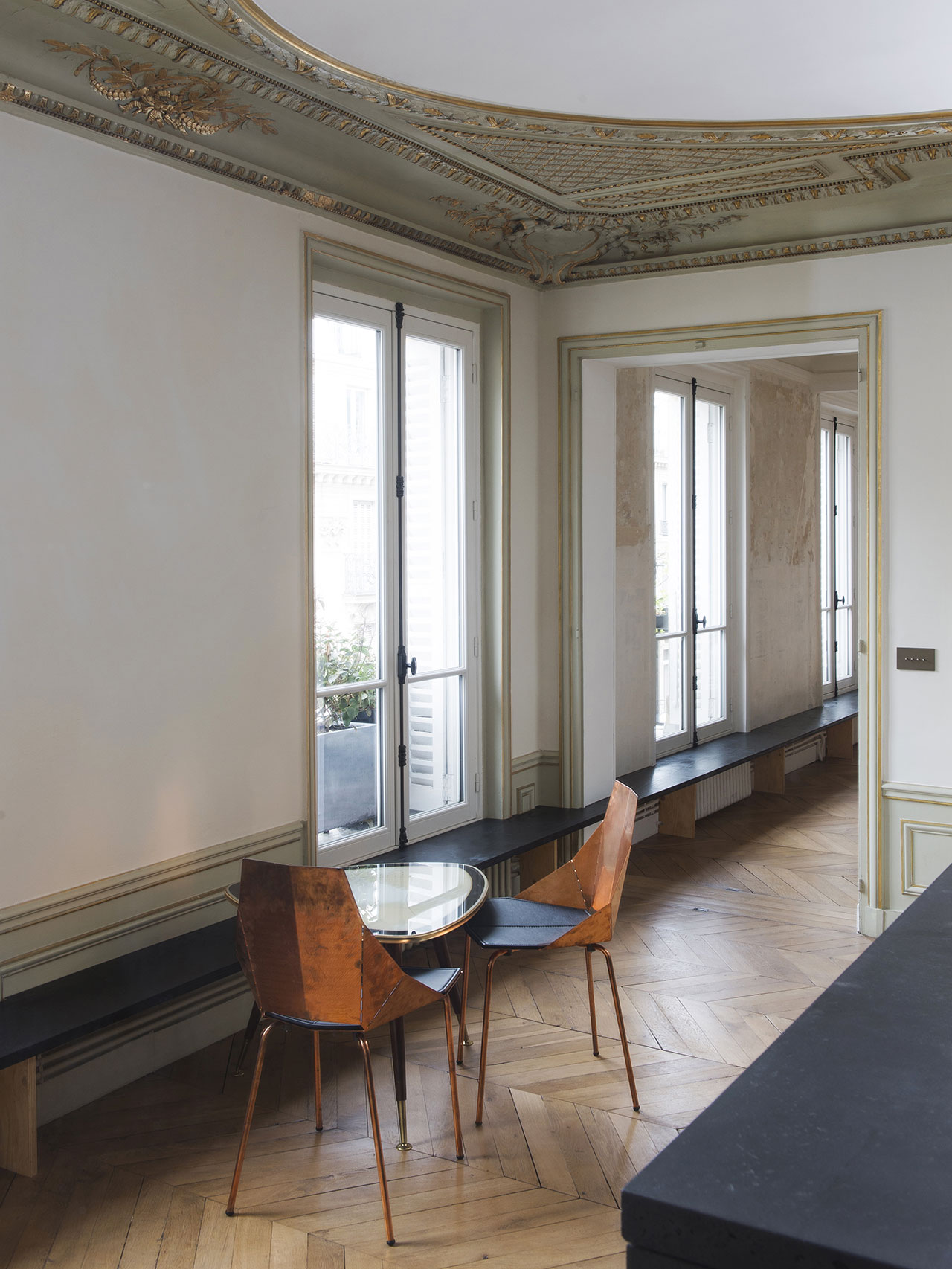 s5_diego_delgado_elias_paris_apartment_photo_by_yannick_labrousse_yatzer how perfect is this design covering the rads and provding great seating for guests at a party. Genius.jpg