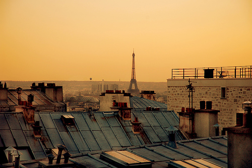 a_view_of_the_eiffel_tower_over_paris_rooftops.jpg