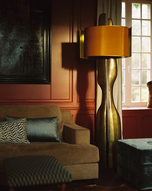 Designer of Sofa & Lamp: Charles Tassin