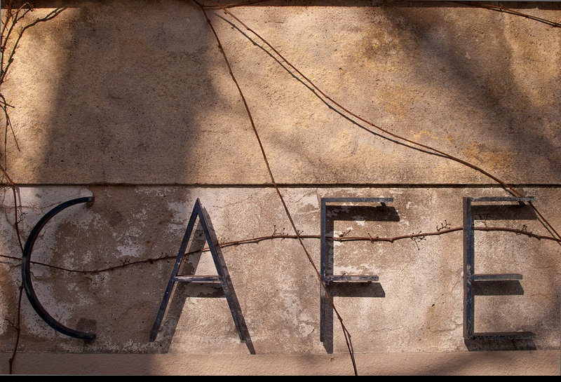 230598-old-metal-brown-facade-signs-and-labeling-signage-photocase-stock-photo-large.jpeg
