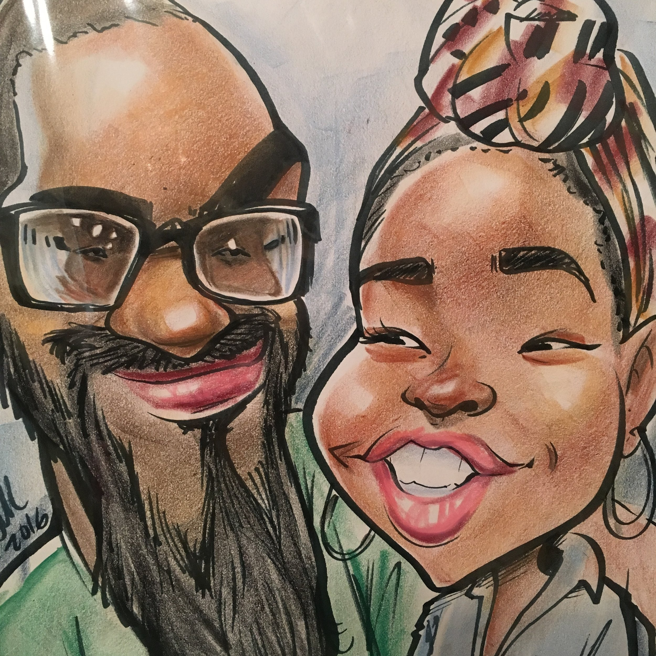 An awesome caricature this guy did of us at the Perry Fair this year when we visited family in GA. (Peep my boo's glasses! Lol)