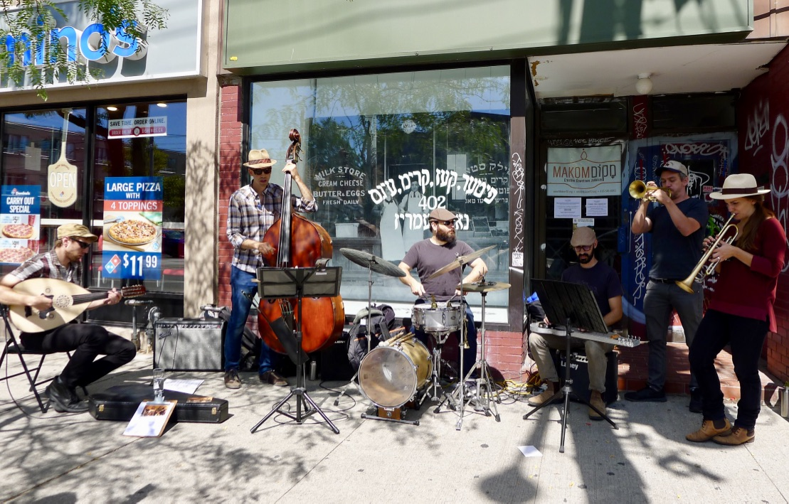 New York's Sandcatchers play a sidewalk concert in front of FENTSTER's Mandel's Dreamery installation, Summer 2016