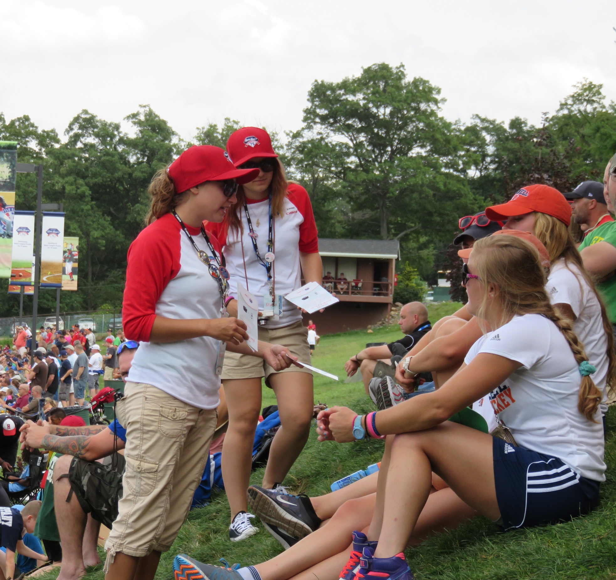 Brand Ambassadors distributing Canon sponsorship booth fliers at the Little League World Series in 2014