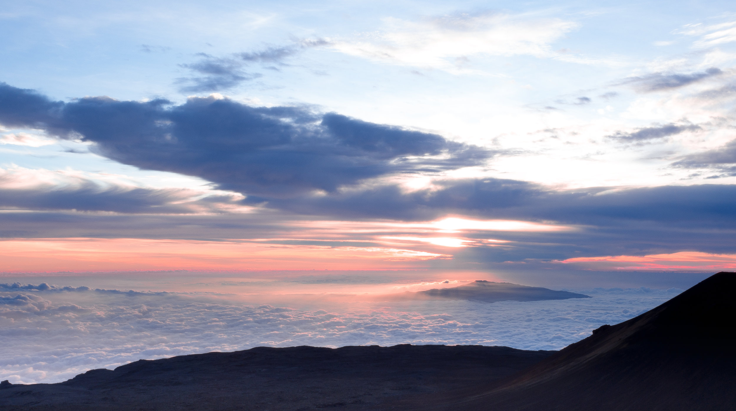 How about  watching the sunset above the clouds from the top of a (dormant)volcano?!