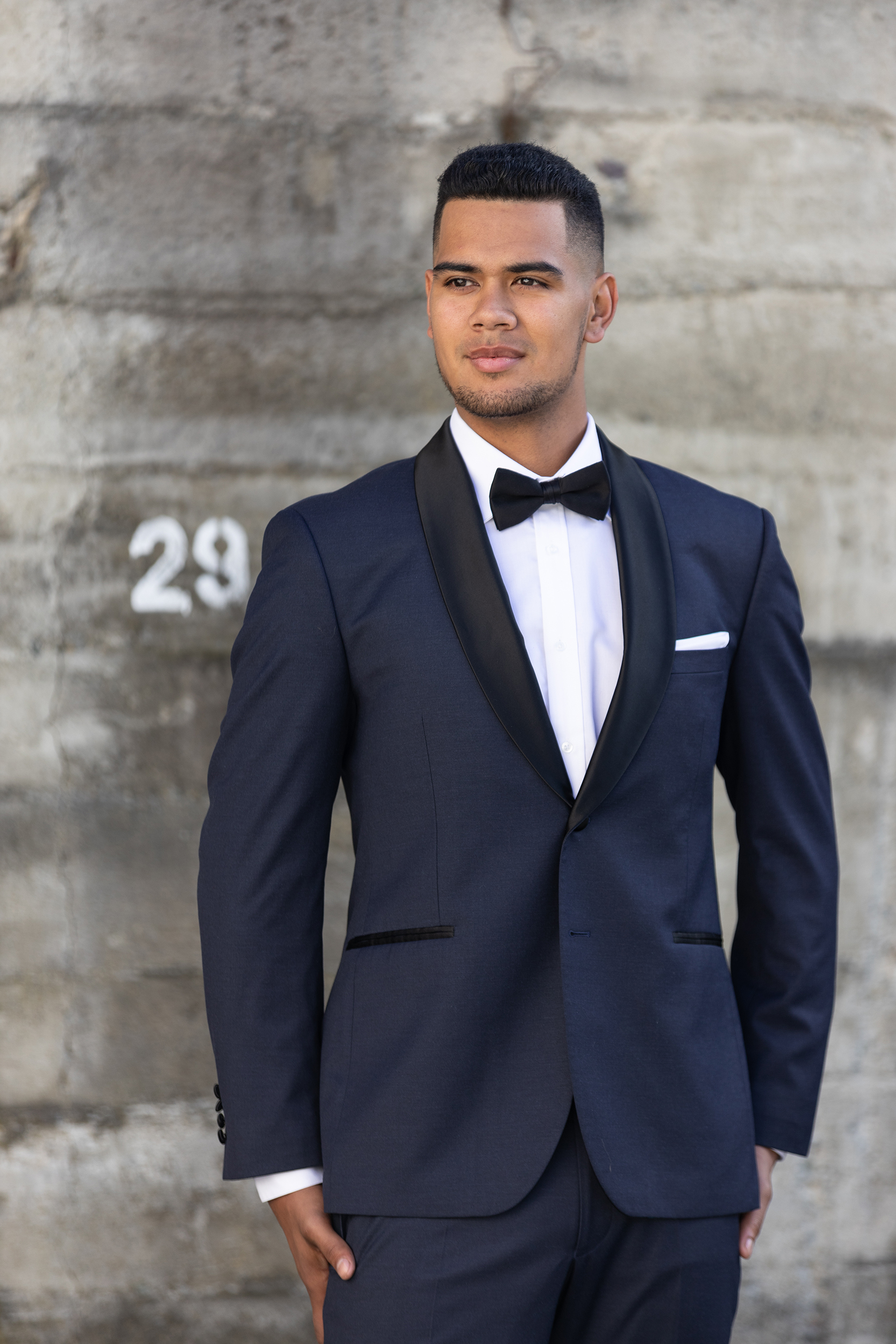 Joe—Navy - Slim Fit- Navy with black collar- Shawl collar with satin finish- 2 button suit jacket- Tapered suit trouserHire price $120 NZDReg: 92—104