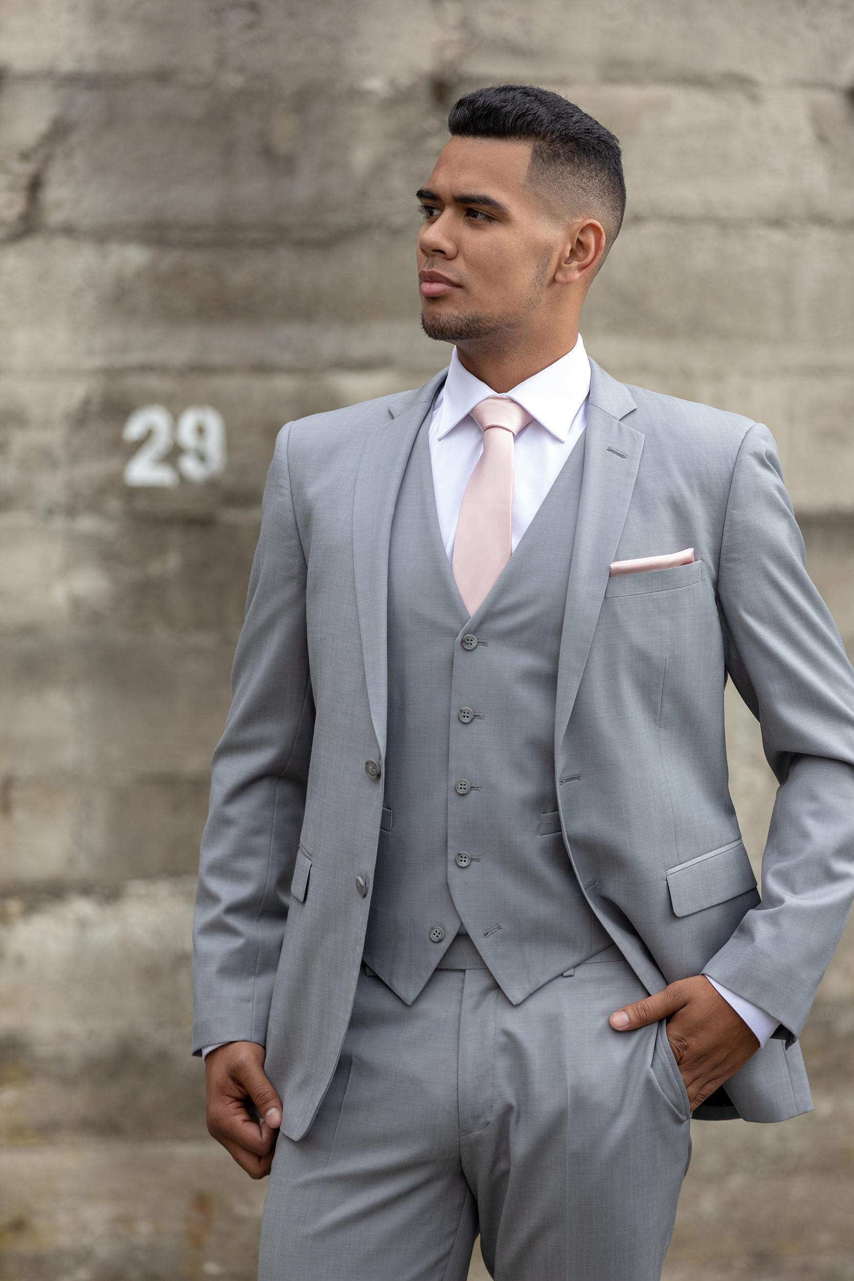 Light grey - Slim Fit- Notch lapel- 2 button suit jacket- Straight leg suit trouserHire price $120 NZDReg: 88—136Short: 88—120Tall: 92—116