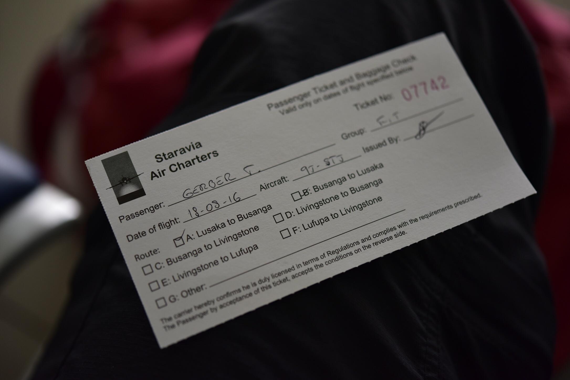 You gotta love the handwritten boarding passes.
