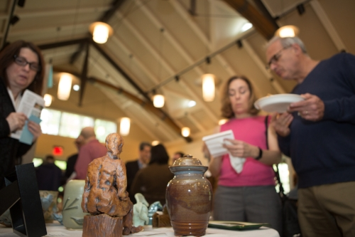Guests mark their favorites from the table of glass and ceramic artworks.Thank you to 3-D artists Leigh Williams, Ann Welch, Paola Bari, Carolyn Edlund, Jeep Johnson, and Larissa Alvarado for their donations and support.
