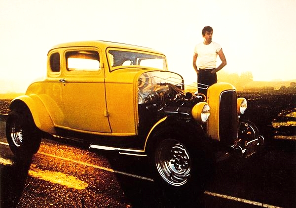 A still from American Graffiti - John Milner and the famous yellow 'deuce - Chev powered