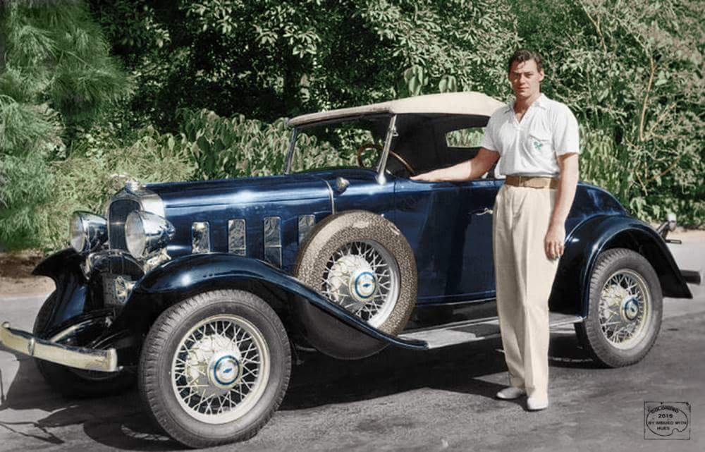The Duke - a young John Wayne poses with his '32 Chevrolet