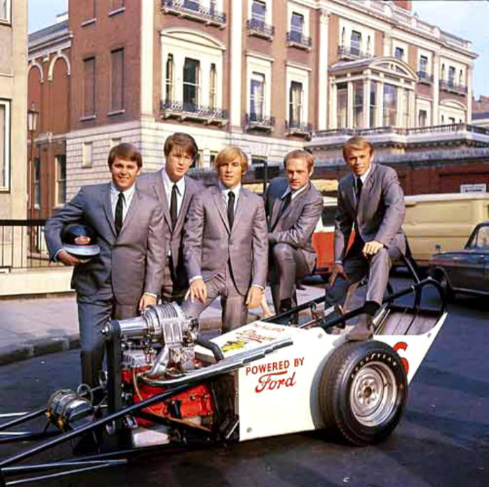 The Beachboys pose with a 4 pot dragster in the UK