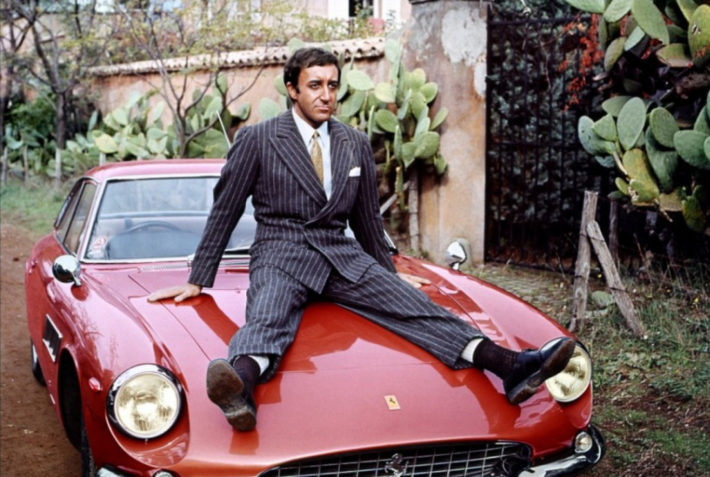 Peter Sellers relaxes on the bonnet of his Ferrari 330GTC