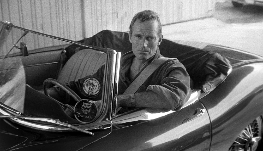 Charlton Heston in an E-Type convertible