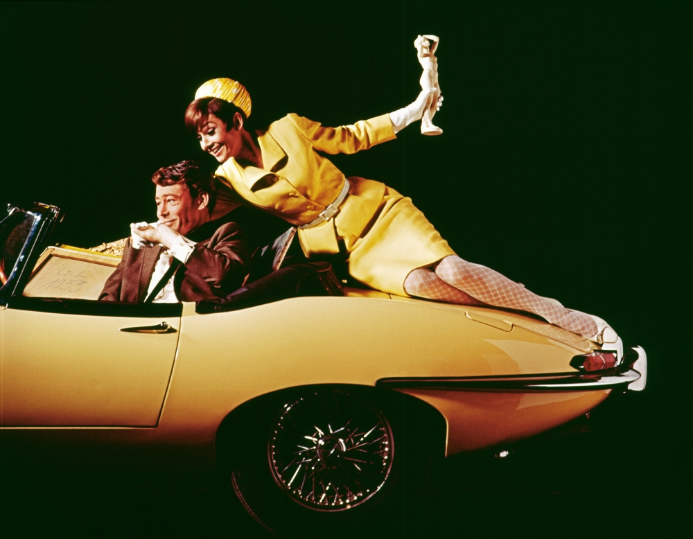 Peter O'Tool and Audrey Hepburn publicity shot in a series 1 E-Type