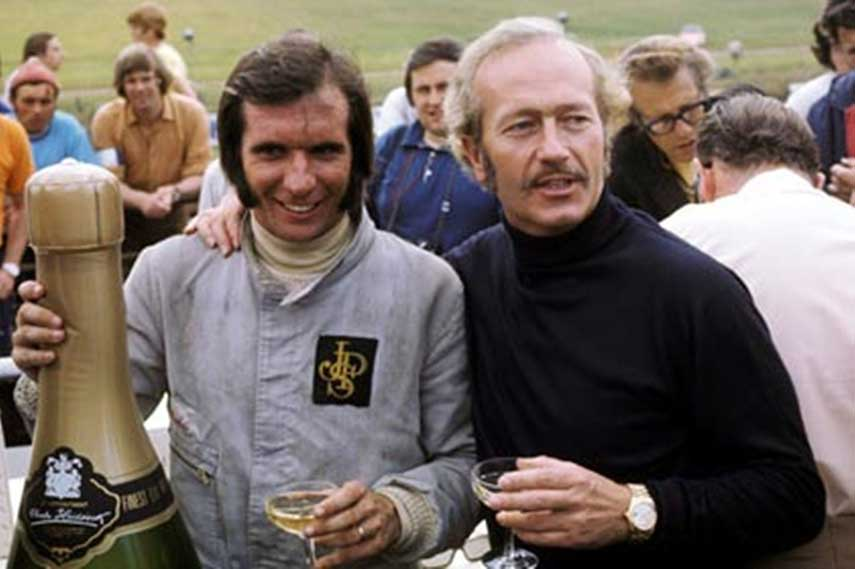 1972 World Champion - Emmerson Fittipaldi (Brazil) with Lotus owner Colin Chapman