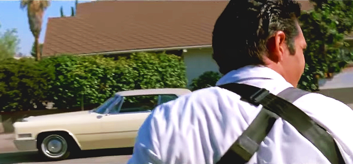 The same '66 Cadillac Coupe DeVille appears in Tarantino's 1992 Reservoir Dogs - seen here with Michael Madsen in the foreground