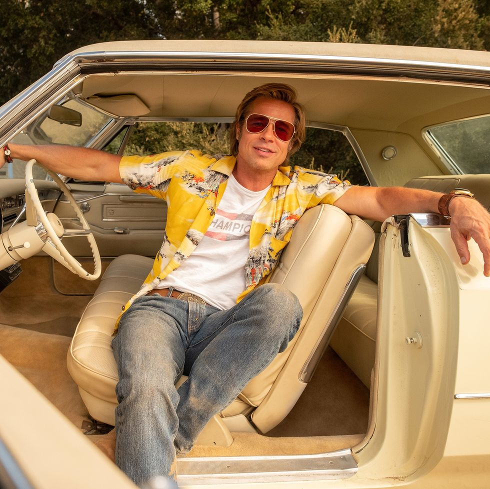 Brad Pitt poses in the '66 Coupe DeVIlle during a break in filming