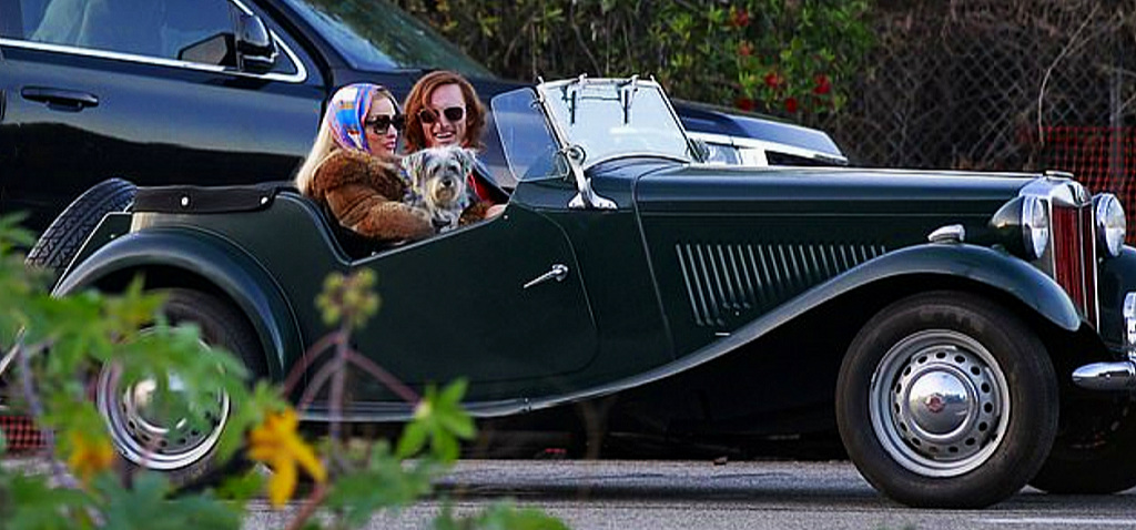 Margot Robbie and Rafal Zawierucha on location and in character waiting for filming to start - MG TD