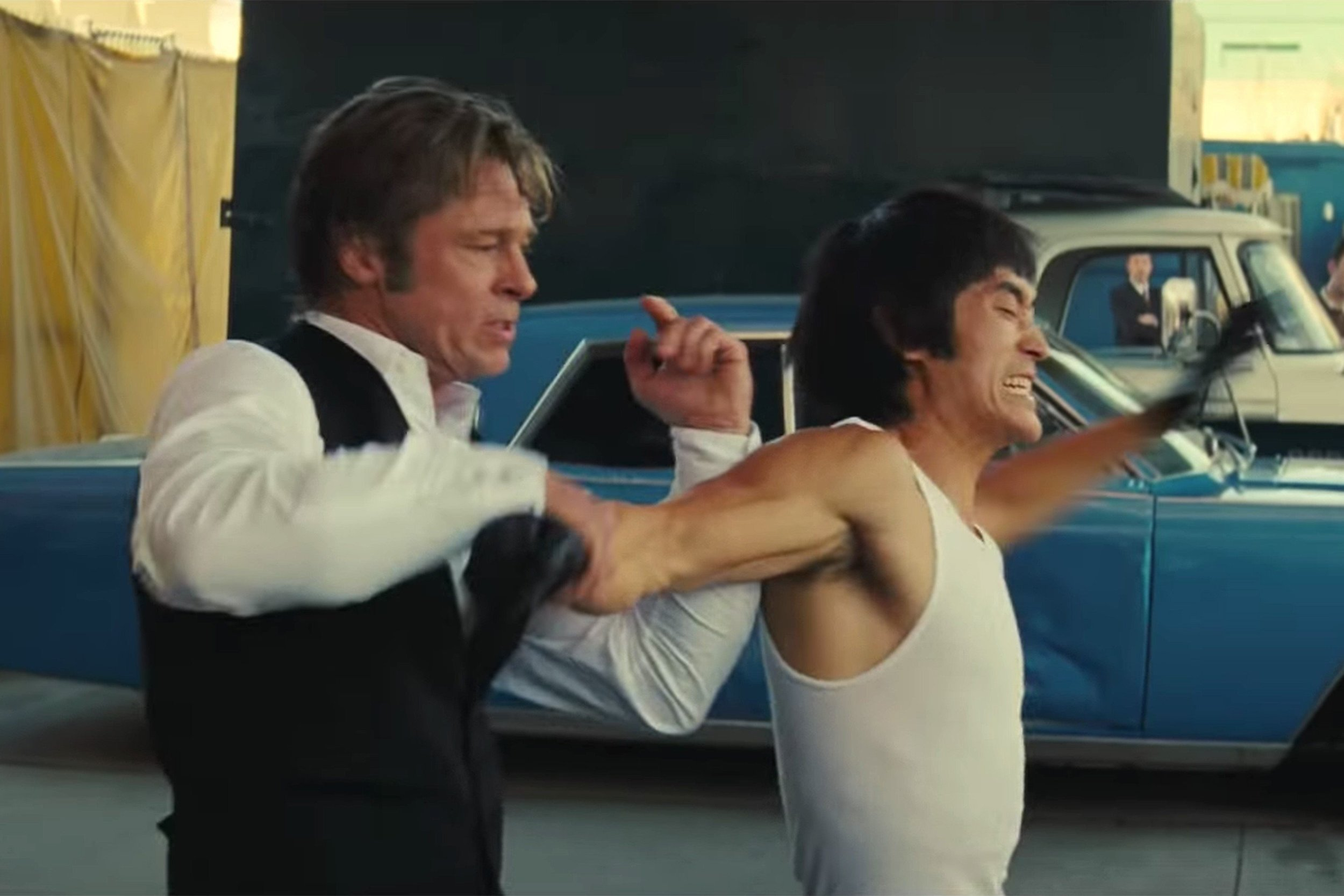 A still from the controversial fight scene with Cliff Booth and Bruce Lee - 1968 Lincoln Continental in the background
