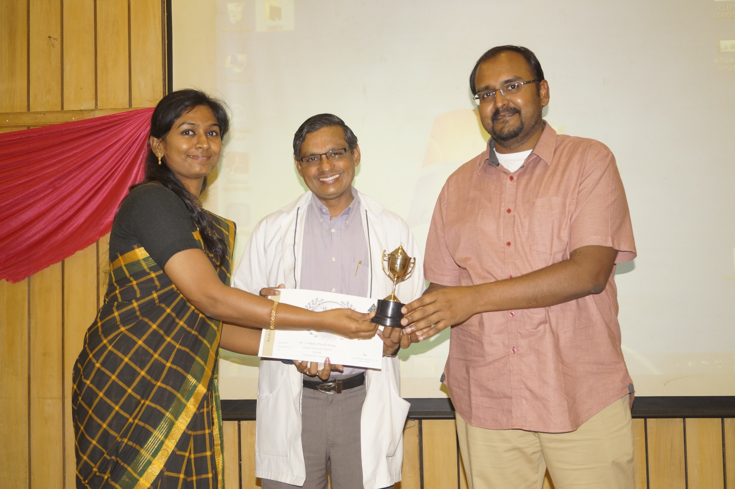 Dr. Delphine receiving Punctuality Award
