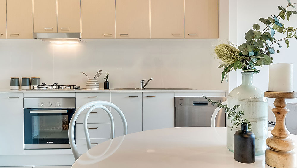 Internal real estate photography of apartment kitchen.