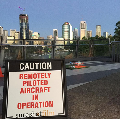Sure Shot Film's sign indicating to the public to take caution because there are 'remotely piloted aircraft in operation'.
