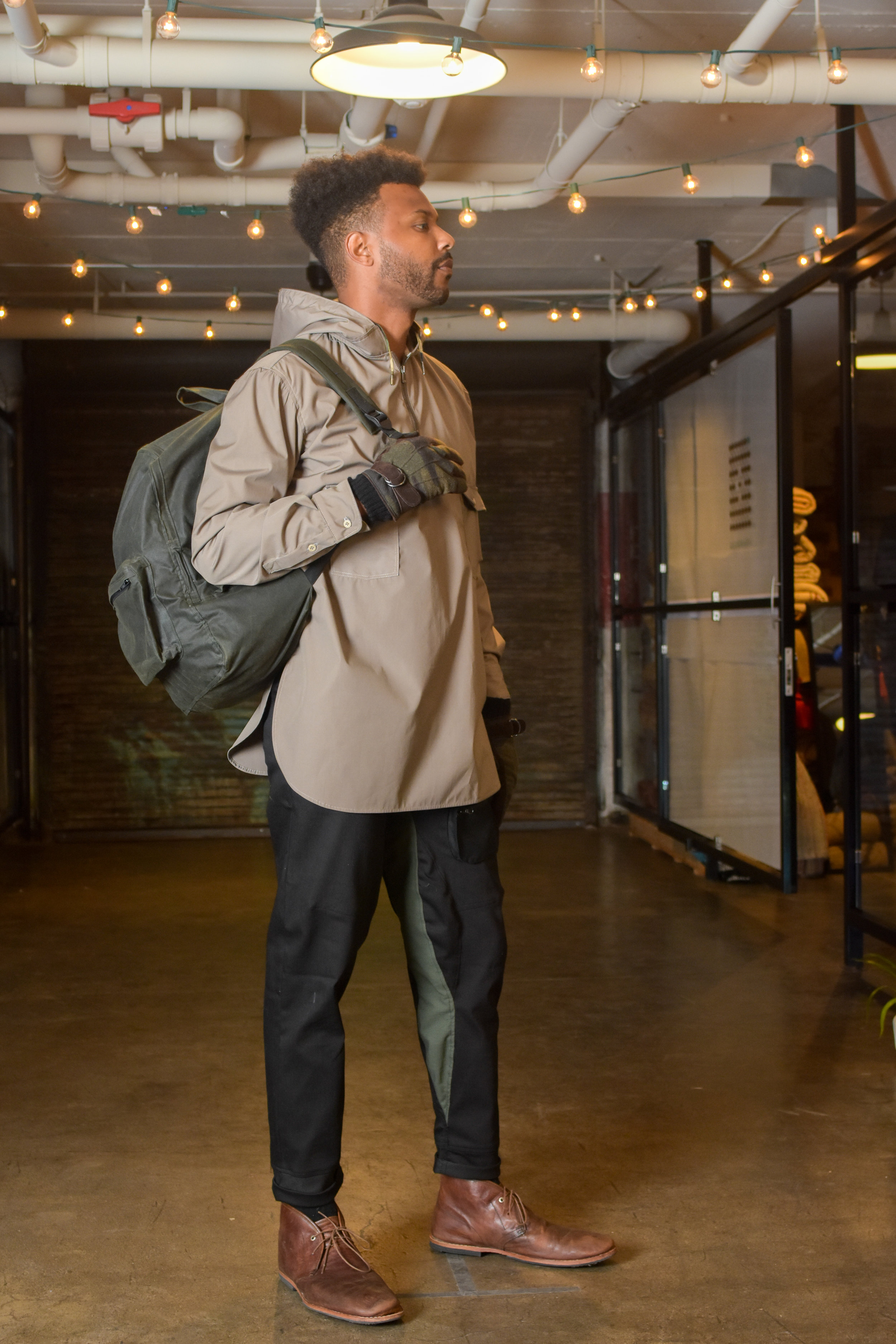 Mercerized cotton pullover shirt, stretch denim trousers with long crotch gusset, large waxed cotton backpack.