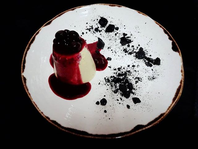 Getting into the #darkmofo spirit with our dessert special |💃🍒vanilla bean bavarois, black cherry, charcoal meringue and wild berry syrup