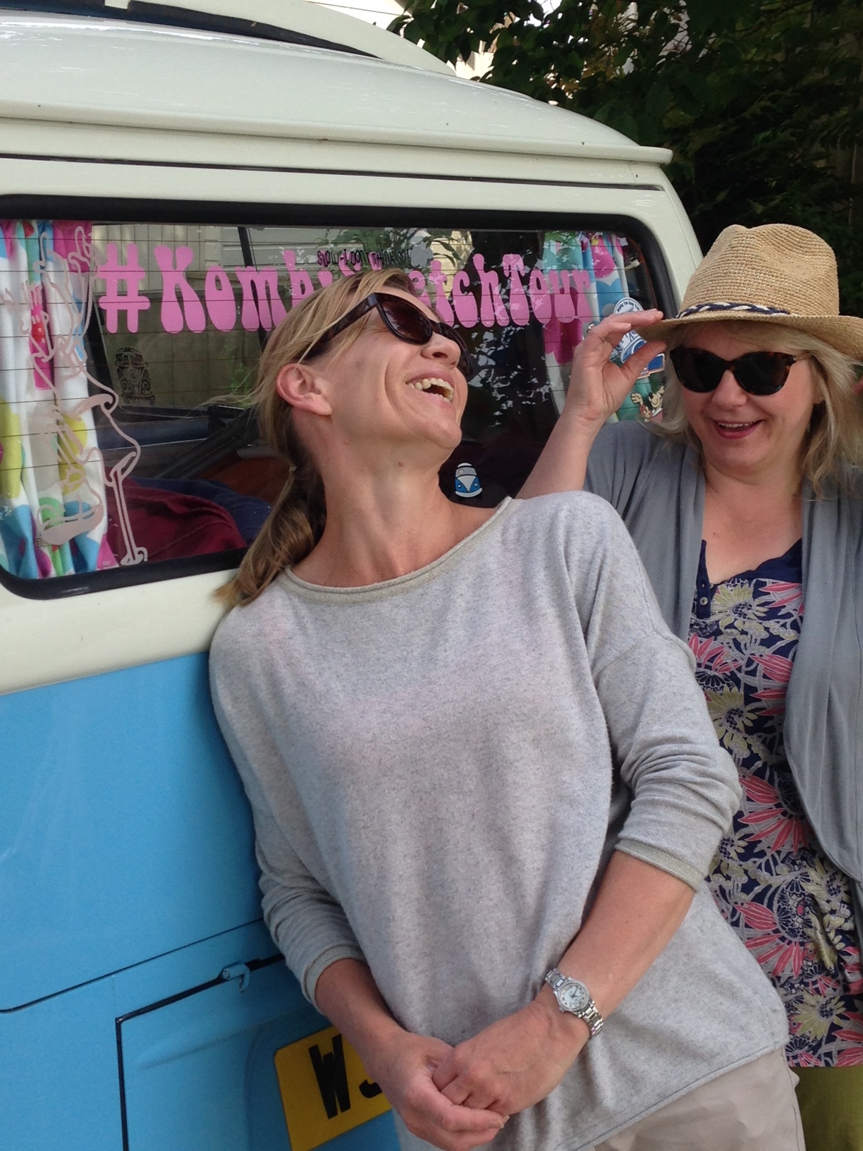 Maxine and Jane laughing by the van