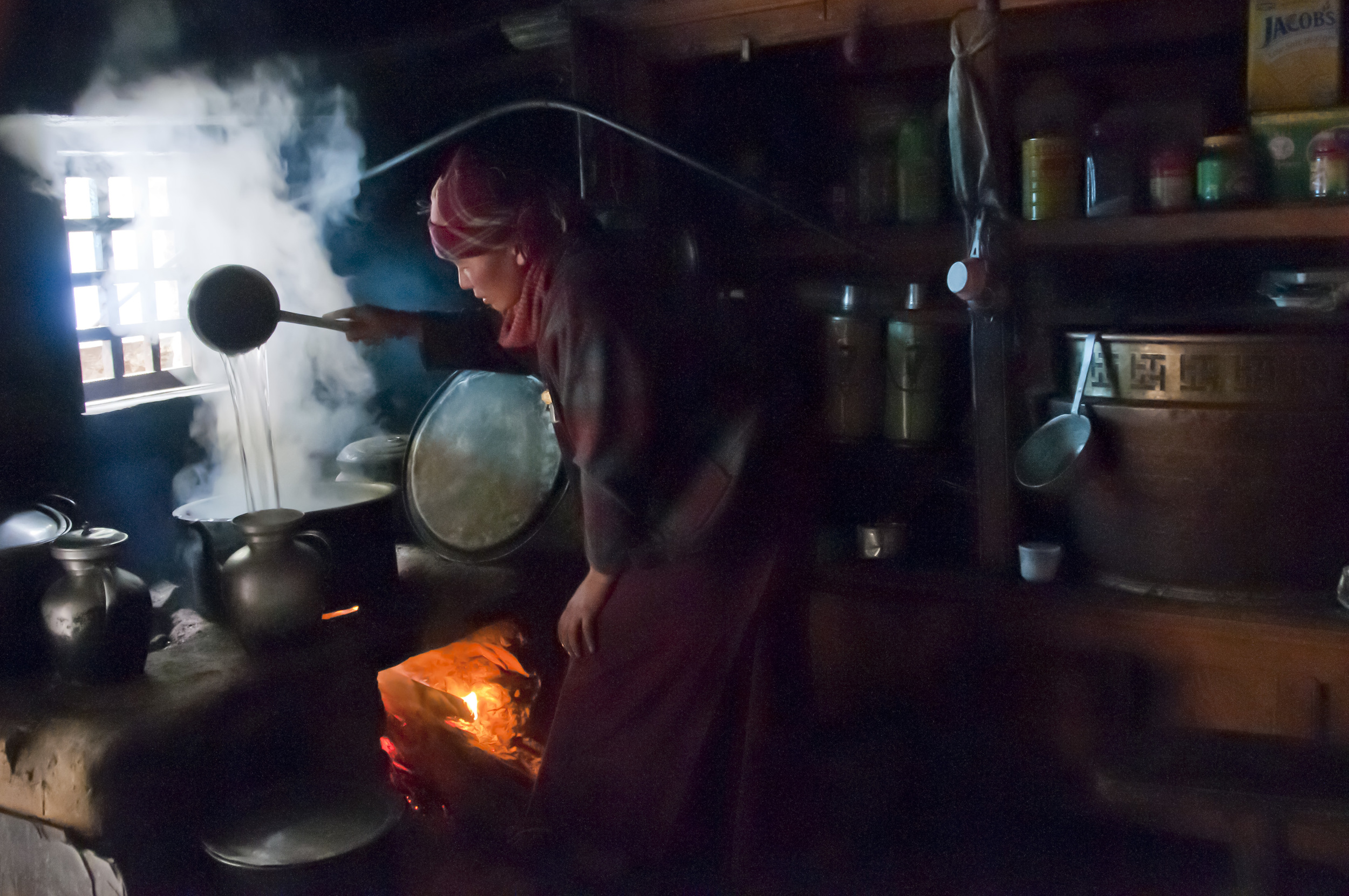 nun in kitchen at Lungdang Gompa R Mendes-Flohr .jpg