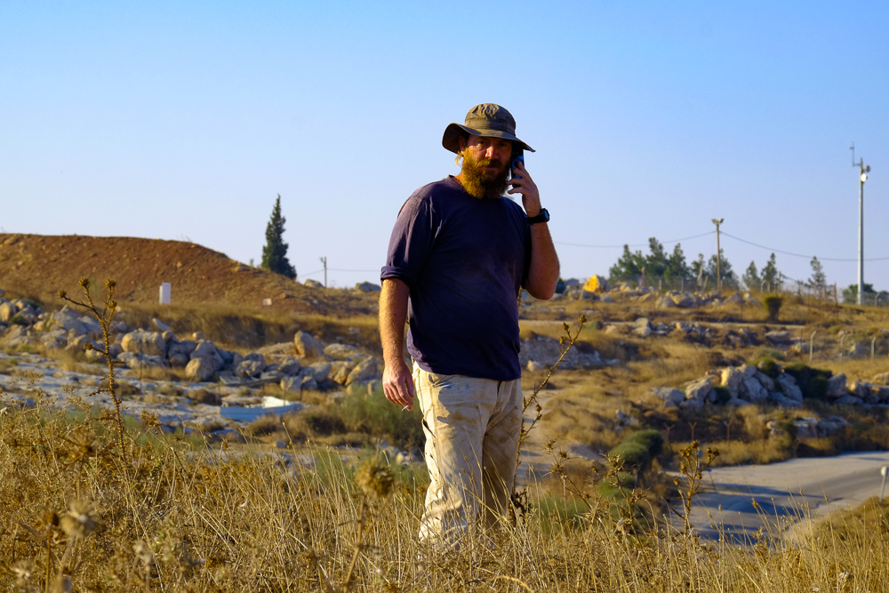the head-settler making his rounds and calling to have the Bedouin expelled