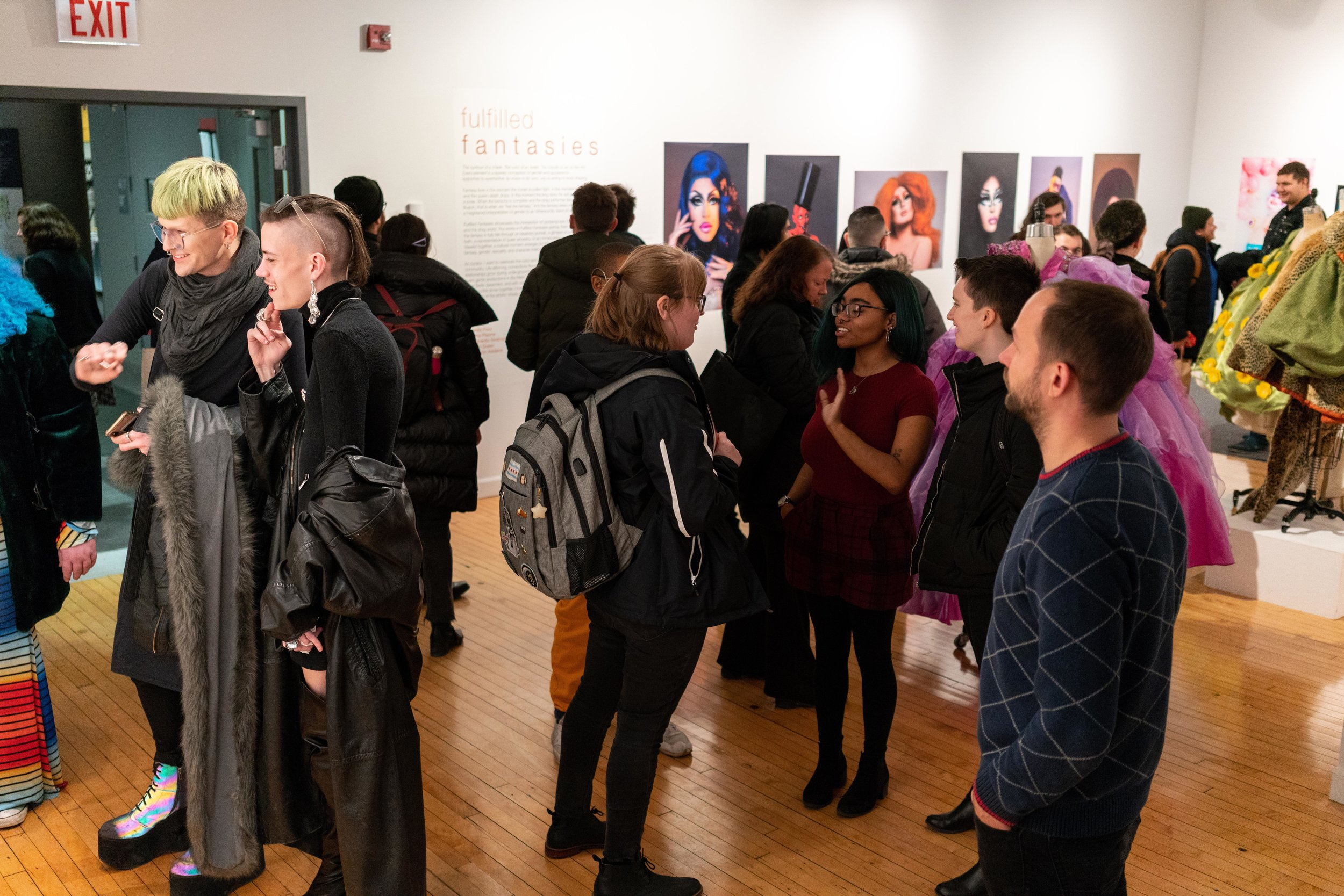 A shot of the attendees from opening night. Adam Ouahmane's photos in background.