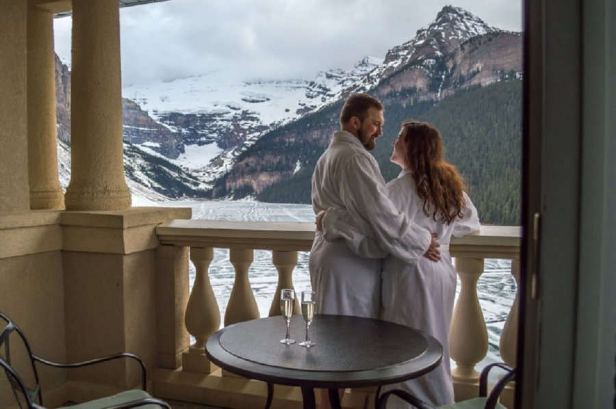 On the balcony during our honeymoon. The best view ever, Lake Louise, Canada.