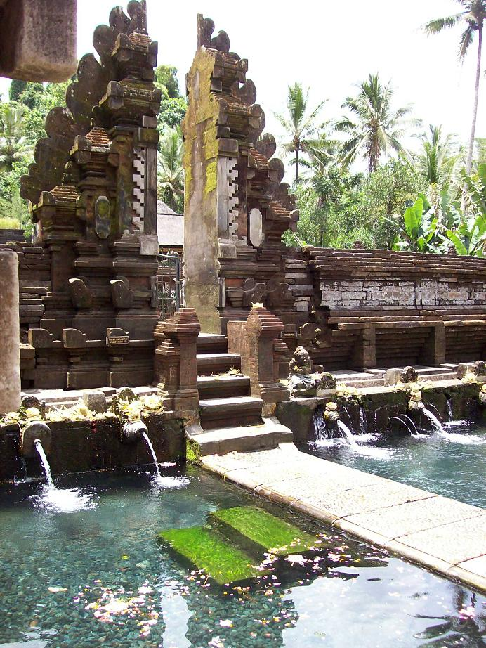 "Pura Tirta Empul Temple  A temple just outside of Ubud where the waters cleanse spirits from sin before prayer. There are 30 ""showers"" with flowing spring water where locals and visitors can wash themselves and soak up the Balinese culture."